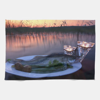 Fresh fish catch on a plate with vegetables tea towel