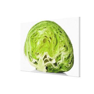 Fresh iceberg lettuce cut in half, on white canvas prints