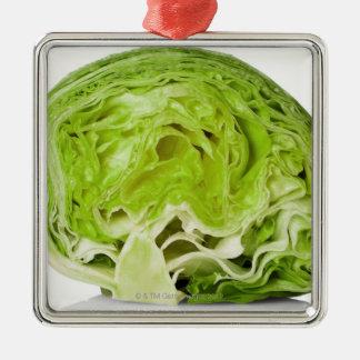 Fresh iceberg lettuce cut in half, on white christmas ornament