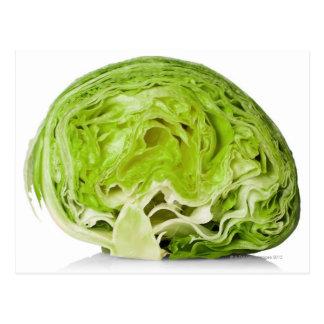 Fresh iceberg lettuce cut in half, on white postcard