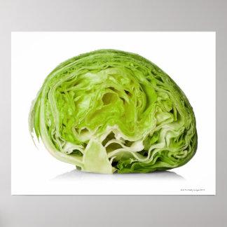 Fresh iceberg lettuce cut in half, on white poster