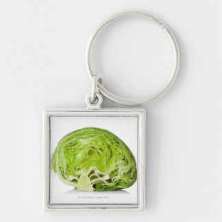 Fresh iceberg lettuce cut in half, on white Silver-Colored square key ring