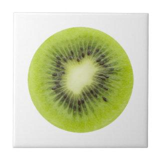 Fresh kiwi fruit. Round slice closeup isolated Tile