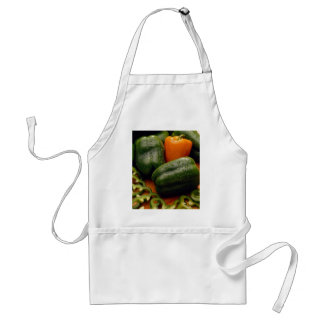 Fresh orange and green bell peppers aprons