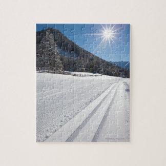 fresh prepared cross-country ski run in a 2 jigsaw puzzle