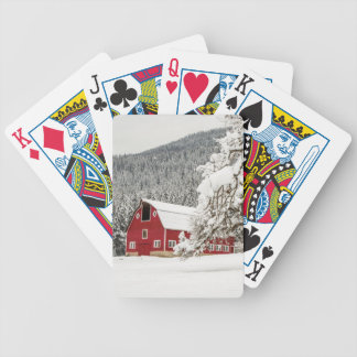 Fresh snow on red barn bicycle playing cards
