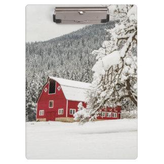 Fresh snow on red barn clipboard