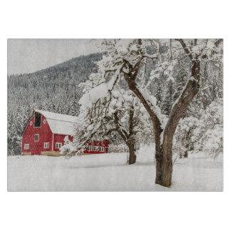 Fresh snow on red barn cutting board
