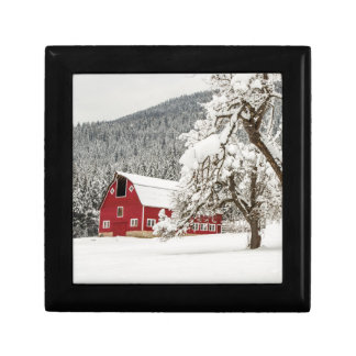 Fresh snow on red barn gift box