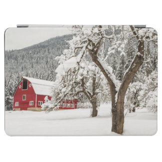 Fresh snow on red barn iPad air cover