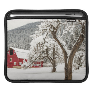 Fresh snow on red barn iPad sleeve