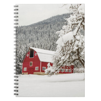 Fresh snow on red barn notebook