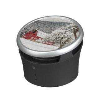 Fresh snow on red barn speaker