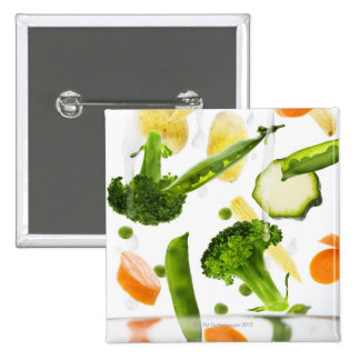 Fresh vegetables with water falling into a bowl buttons