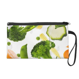 Fresh vegetables with water falling into a bowl wristlet purse