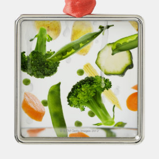 Fresh vegetables with water falling into a bowl Silver-Colored square decoration