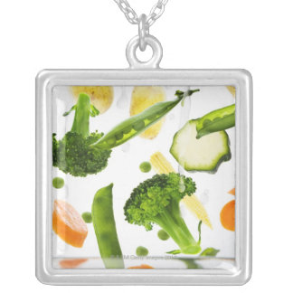 Fresh vegetables with water falling into a bowl silver plated necklace