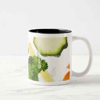 Fresh vegetables with water falling into a bowl Two-Tone coffee mug