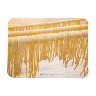 Freshly made pasta drying on a wooden rack rectangular photo magnet