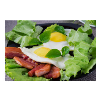 Fried eggs with herbs, lettuce and  bacon poster