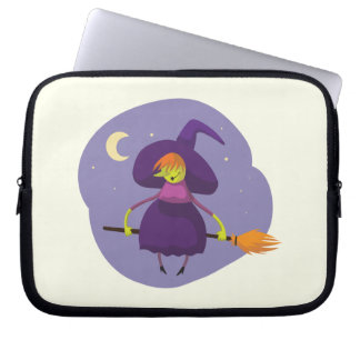 Friendly witch flying on broom at night halloween computer sleeves