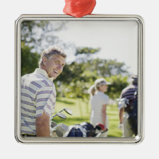 Friends carrying golf bags christmas ornament