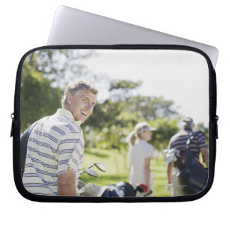 Friends carrying golf bags laptop computer sleeve