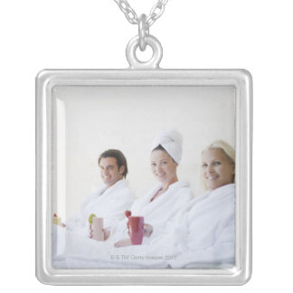 Friends drinking fruit smoothies at spa silver plated necklace