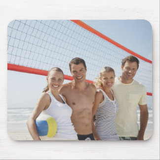 Friends on beach volleyball court mouse mat