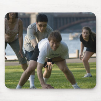 Friends playing game of football mouse pad