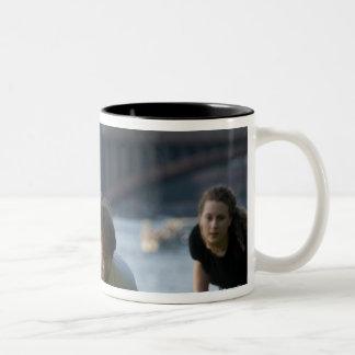 Friends playing game of football Two-Tone coffee mug