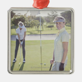 Friends playing golf christmas ornament
