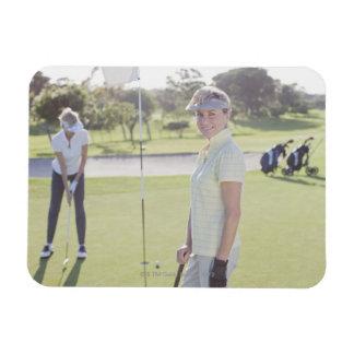 Friends playing golf vinyl magnet