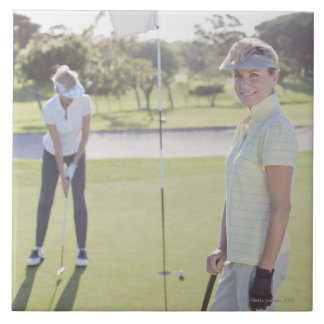 Friends playing golf tile