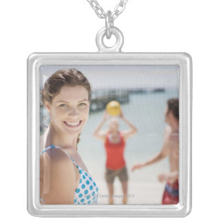 Friends playing volleyball at beach silver plated necklace