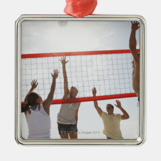 Friends playing volleyball christmas ornament