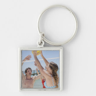 Friends playing volleyball on beach Silver-Colored square key ring