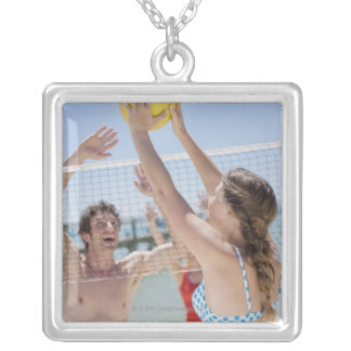 Friends playing volleyball on beach silver plated necklace