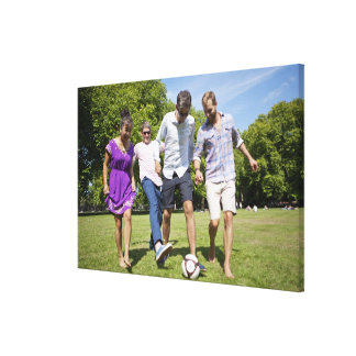 Friends Playing with a Football in a City Park Canvas Print