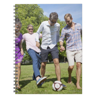 Friends Playing with a Football in a City Park Notebooks
