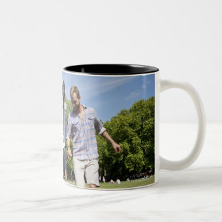 Friends Playing with a Football in a City Park Two-Tone Coffee Mug
