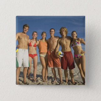 Friends posing on beach with volleyballs 15 cm square badge