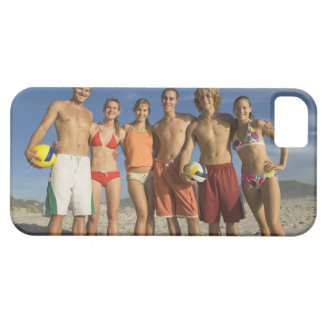Friends posing on beach with volleyballs iPhone 5 cover