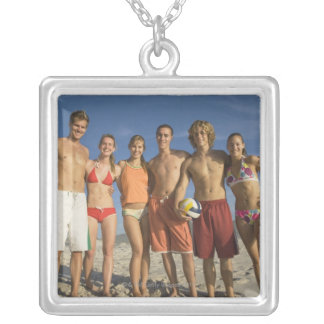 Friends posing on beach with volleyballs silver plated necklace