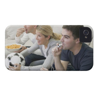 Friends watching TV with whistle, football and Case-Mate iPhone 4 Case