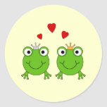 Frog Princess and Frog Prince, with hearts. Round Sticker