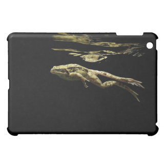 frog swimming in the dark just below the surface iPad mini covers