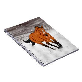 Frolicking Buckskin Horse in Snow Spiral Notebook