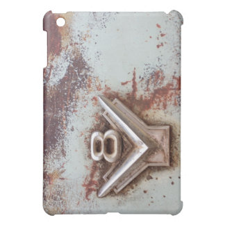 From classic car: Rusty old v8 emblem in chrome Cover For The iPad Mini