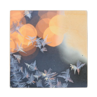 Frost patterns on window with bokeh twinkle wood coaster